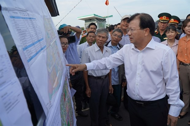 Deputy Prime Minister Trinh Dinh Dung checks land clearance work for the construction of Long Thanh airport during his field trip to Dong Nai province last month. (Photo: VNA)